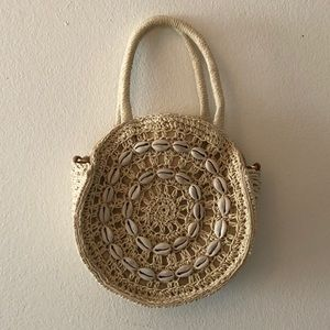Shell embellished small woven bag